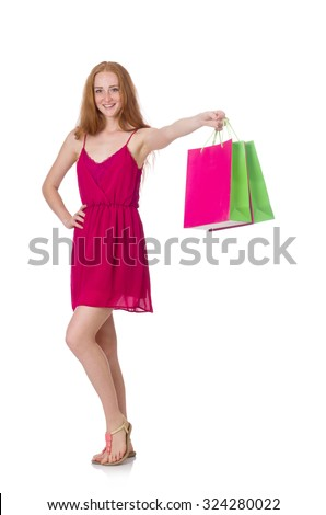 Woman with shopping bags isolated on white #324280022