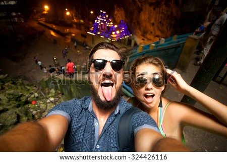 Outdoor portrait of beautiful traveling couple,hiker couple,hipster outfit,make selfie of their Asia trip,happy laughing couple,couple in sunglasses,emotional man and tongue girl,crazy selfie,hikers