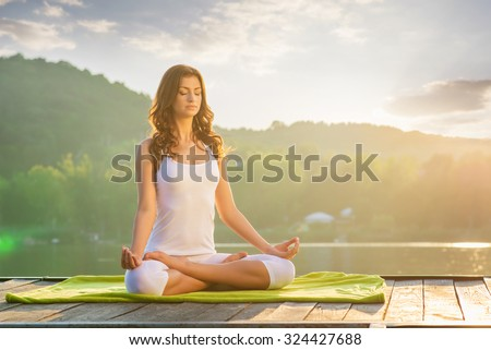 Woman Yoga - relax in nature #324427688