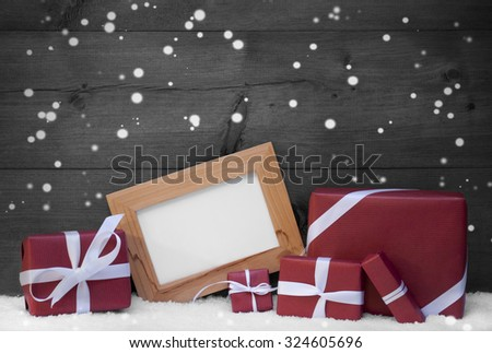 Red, Gray Christmas Decoration On Snow, Snowflakes, Christmas Gifts, Presents. Picture Frame. Copy Space For Advertisement. Rustic, Vintage Wooden Background. Festive Snowy Card. Black And White Image