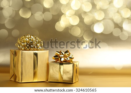 Golden gift boxes on abstract background #324610565