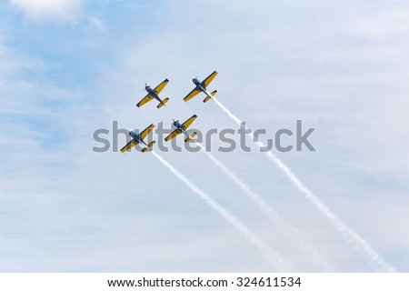 Airplanes on airshow. Aerobatic team performs flight at air show #324611534