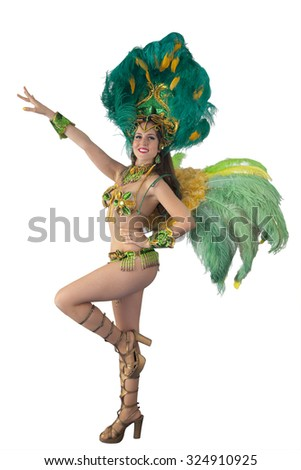 Beautiful samba dancer in green carnival costume dancing and looking at camera. Isolated on white background. #324910925