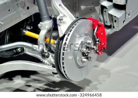 Car suspension with disc brake. Royalty-Free Stock Photo #324966458