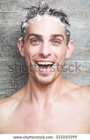 Young attractive man cheerfully washes her head #325010399