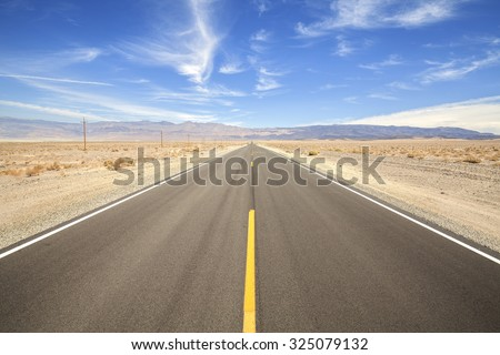Endless country highway in Death Valley, travel adventure concept, USA. #325079132