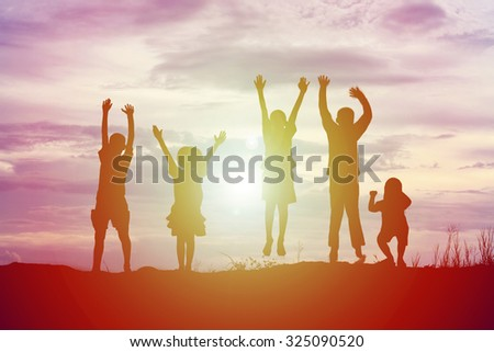 silhouette of a happy children and happy time sunset #325090520