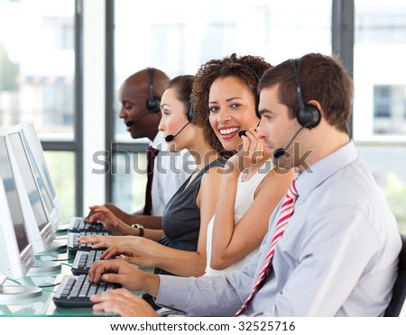 African-American businesswoman working in a call center with her colleagues #32525716