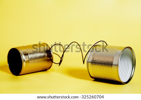 tin can phone.communication concept. Royalty-Free Stock Photo #325260704