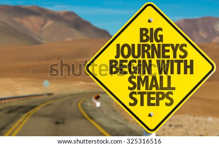Big Journeys Begin With Small Steps sign on desert road #325316516