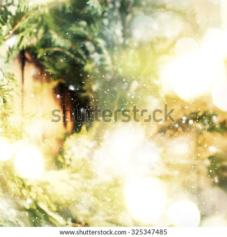 Christmas Background with Natural Wreath on Wooden Background and Festive Light. Warm toned #325347485