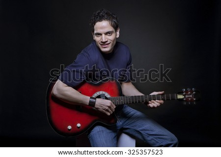 Young man playing the guitar #325357523