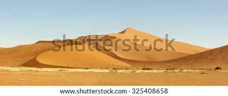 Incredible huge dunes of sand located in Sossusvlei in Namibia within the Namid desert #325408658