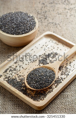 Chia seed on a wooden spoon against burlap background #325451330