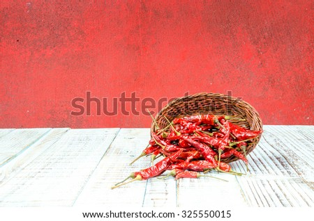 Red hot chili peppers on old wooden table #325550015