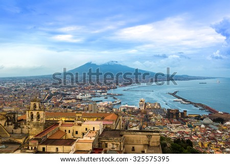 Napoli (Naples) and mount Vesuvius in the background at sunset in a summer day, Italy, Campania #325575395