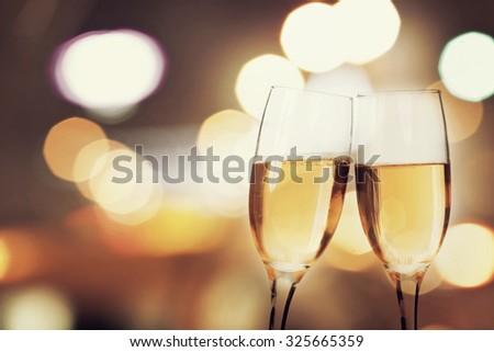 Champagne glasses on sparkling background #325665359