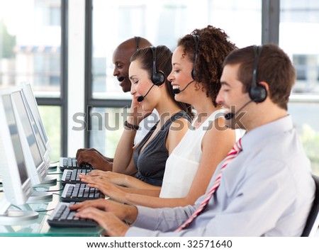 Young businesswoman working in a call center with his colleagues #32571640
