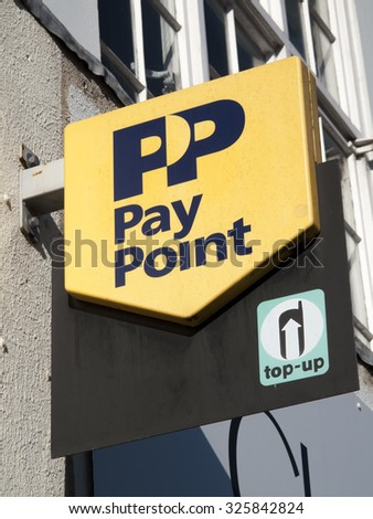 Newbury, Market Place, Berkshire, England - October 10, 2015: PP Pay Point and mobile phone top up facility sign over retail premises #325842824