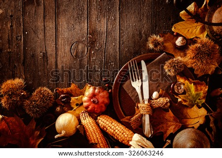 Thanksgiving dinner. Autumn fruit with plate and cutlery. Thanksgiving autumn background