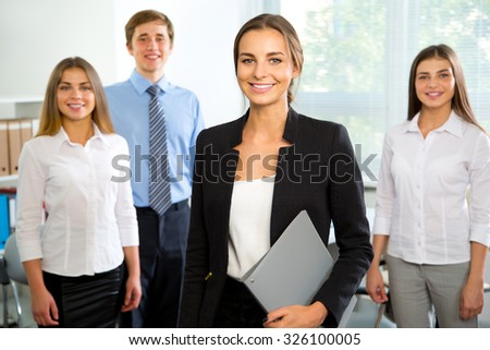 Group of business people with businesswoman leader on foreground #326100005