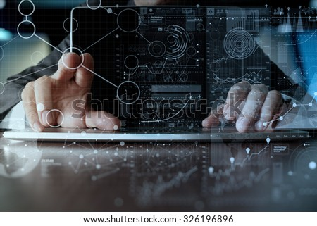 businessman hand working on laptop computer with digital layer business strategy and social media diagram on wooden desk   #326196896