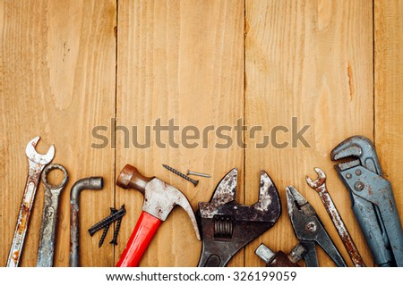 Many tools on wooden background #326199059