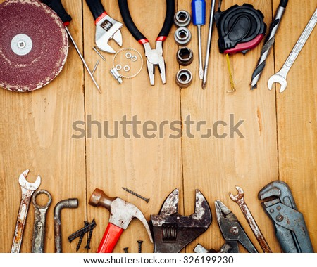 Many tools on wooden background #326199230