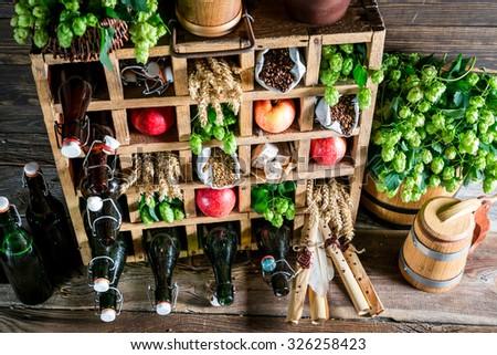 Various beer ingredients in wooden box #326258423