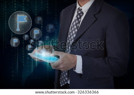 Businessman hand touch screen flag icons on a tablet. #326336366