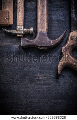 Composition of vintage rusted construction tools on wooden board. #326398328
