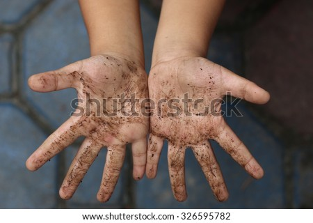 Hands dirty boy Royalty-Free Stock Photo #326595782