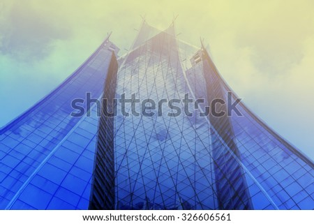 Panoramic and perspective wide angle view to steel light blue background of glass high rise building skyscraper commercial modern city of future. Business concept of success industry tech architecture #326606561