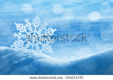 Christmas background with a decorative snowflake on brilliant snow Royalty-Free Stock Photo #326622242