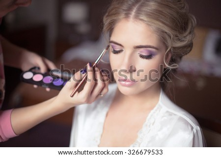 Beautiful Bride Portrait wedding makeup, wedding hairstyle, Wedding dress. Professional stylist makes make-up. soft selective focus.  #326679533