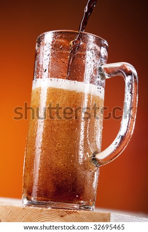 Big tall mug of fresh beer with foam isolated on brown background #32695465