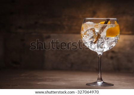 Gin tonic on a wooden background #327064970