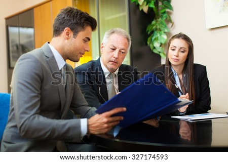 Business people at work Royalty-Free Stock Photo #327174593