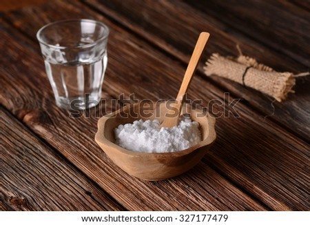 baking soda into the bowl with wooden spoon #327177479