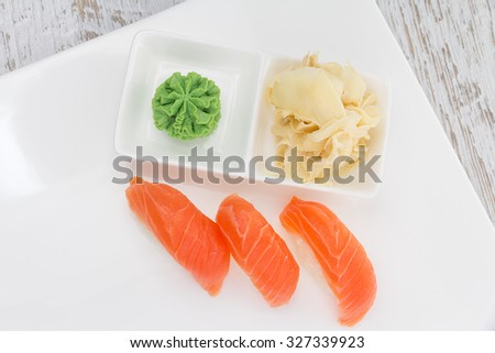 Salmon sushi nigiri on a white plate #327339923