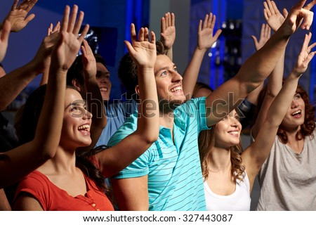 party, holidays, celebration, nightlife and people concept - smiling friends waving hands at concert in club #327443087