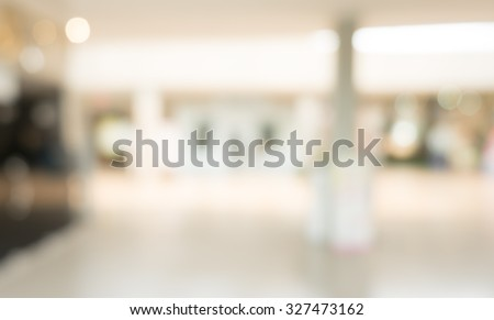 blurred image of shopping mall and people . #327473162
