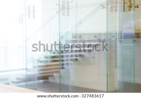 Defocused Office Building Lobby or hospital Background. Image staircase, glass walls and doors. Modern interior.