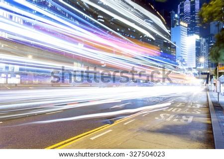 Car trail during Hong Kong dark night with high building #327504023