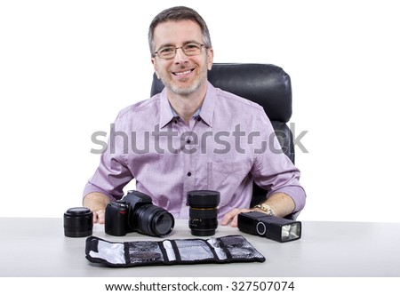 Professional photographer showing how to use camera gear.  He is isolated on a white background.