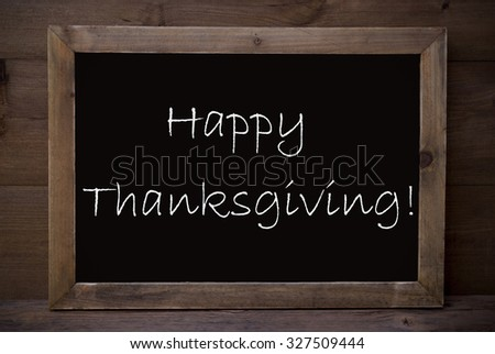 Brown Blackboard With English Text Happy Thanksgiving As Greeting Card. Wooden Background. Vintage Rustic Style.