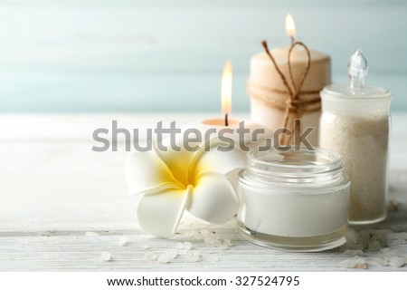 Spa coconut products on light wooden background #327524795