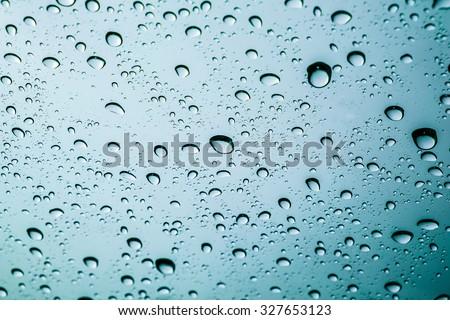 Drops of rain on a window glass. #327653123