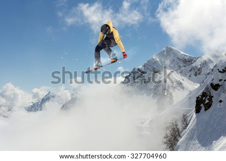 Flying snowboarder on mountains, extreme sport #327704960