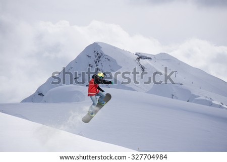 Flying snowboarder on mountains, extreme sport #327704984